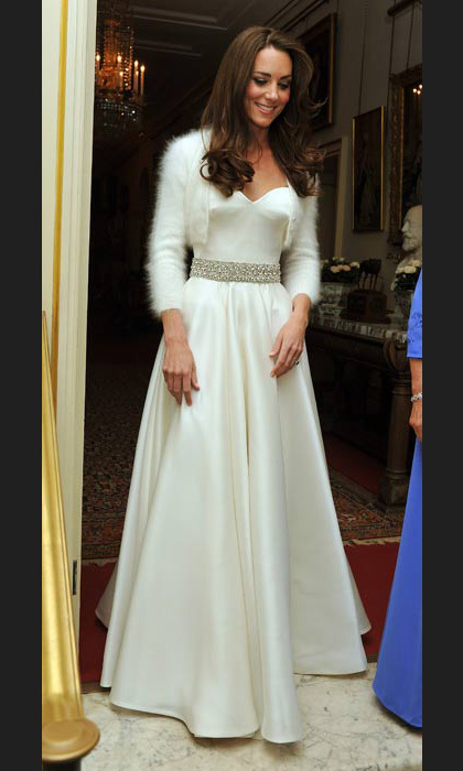 After wowing the world over in a magnificent Alexander McQueen gown when she married Prince William on 29 April, 2011, Kate changed into this equally stunning satin number with a fur bolero.