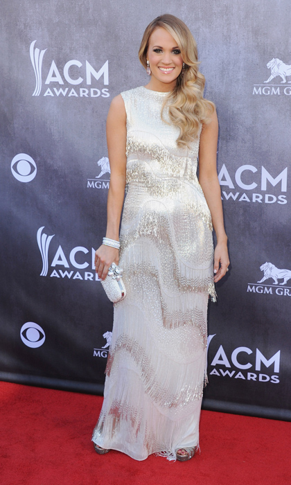 Carrie Underwood shone bright at the AMA awards in a shimmery fringe dress. (Photo by Jon Kopaloff/FilmMagic)