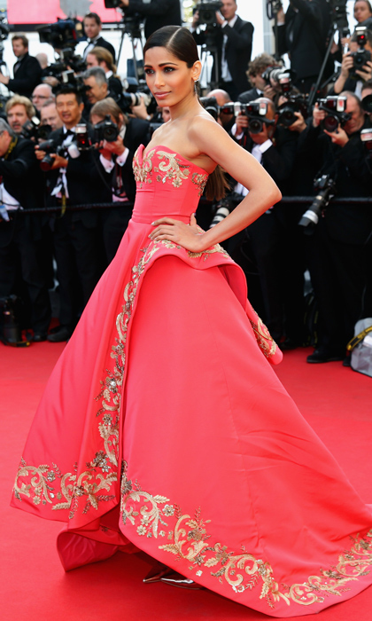 Freida Pinto was breathtaking in a coral ball gown with stunning gold embroidery at Cannes. (Photo by Vittorio Zunino Celotto/Getty Images)