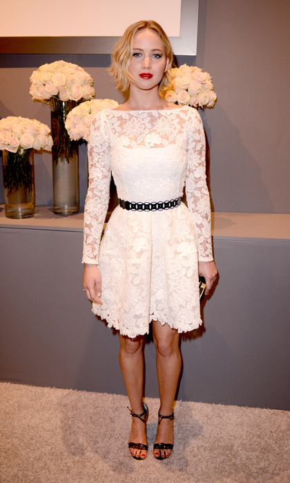 Paying homage to the late designer, Jennifer Lawrence donned a white lace Oscar de la Renta cocktail number for the Elle Women in Hollywood event. (Photo by Jeff Vespa/Getty Images for ELLE)
