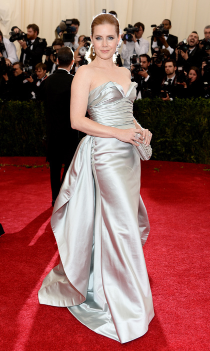 At the Met Gala, Amy Adams was the epitome of Hollywood glamour in a silver satin gown. (Photo by Dimitrios Kambouris/Getty Images)
