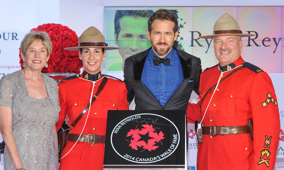 "HE'S A PROUD CANADIAN: Ryan returned home this month to unveil his star on Canada's Walk of Fame. Receiving the honour on home soil not only meant the world to Ryan, but also to his mother, Tammy, who accompanied her son on the red carpet. ""When I first heard about [the star] I called my mom. This is as big an honour for her as it is for me,"" he tells 'Hello!.' (Photo: Getty Images)"
