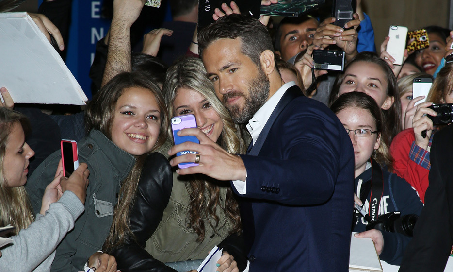 RYAN REYNOLDS: At this year's Toronto International Film Festival, the Vancouver native greeted each and every fan that showed up to the premiere of his crime thriller, 'The Voices.' (Photo: Getty Images)