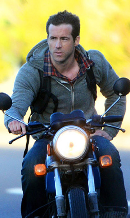 "HE'S ADVENTUROUS: ""There's an incredible sense of freedom in being out on the open road,"" Ryan has said about his passion for motorcycles. He also does all his own movie stunts! (Photo: Getty Images)"