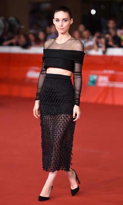 Rooney Mara doubled up on the year's biggest trends in a combination sheer underlay and over-the-shoulder crop top with a layered skirt and sling-back pumps by Balenciaga at the 'Trash' film premiere in Rome.