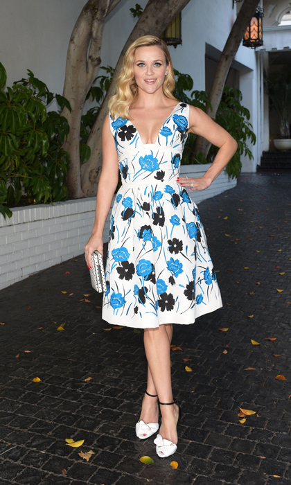 Reese Witherspoon charmed in a flared floral dress by the late Oscar de la Renta at the 2014 CDFA/Vogue Fashion Fund event, and complemented her look with Giuseppe Zanotti's two-tone safety-pin sandals and an L.K. Bennett clutch.