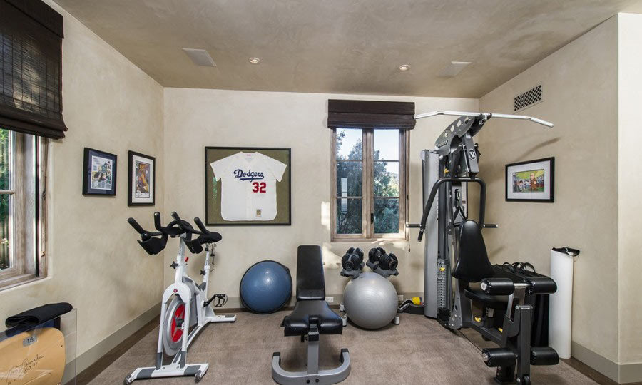 Lady Gaga will never have to worry about getting to a gym! Her California estate has a full gym, which will keep her in tip top shape between tours. (Image: Zillow)