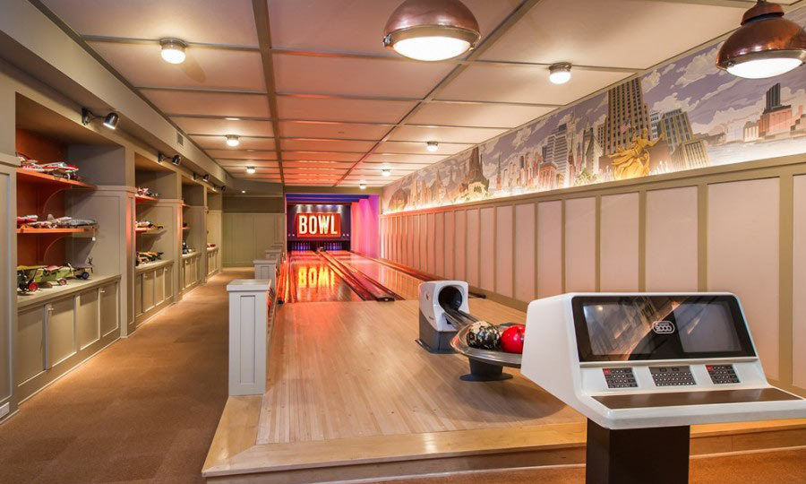 "This place has a retro bowling alley, dubbed ""the batcave"" by its previous owner. With amenities like these, we wonder if Lady Gaga will ever need to leave. (Image: Zillow)"