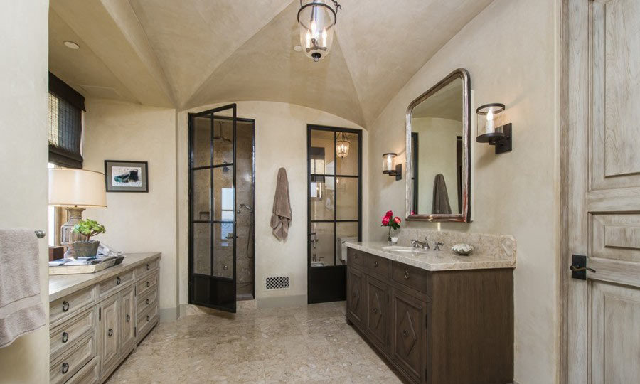 This bathroom is every bit the sanctuary - massive, well-lit and with plenty of space to try on different outfits (even elaborate costumes for a performance!) (Image: Zillow)