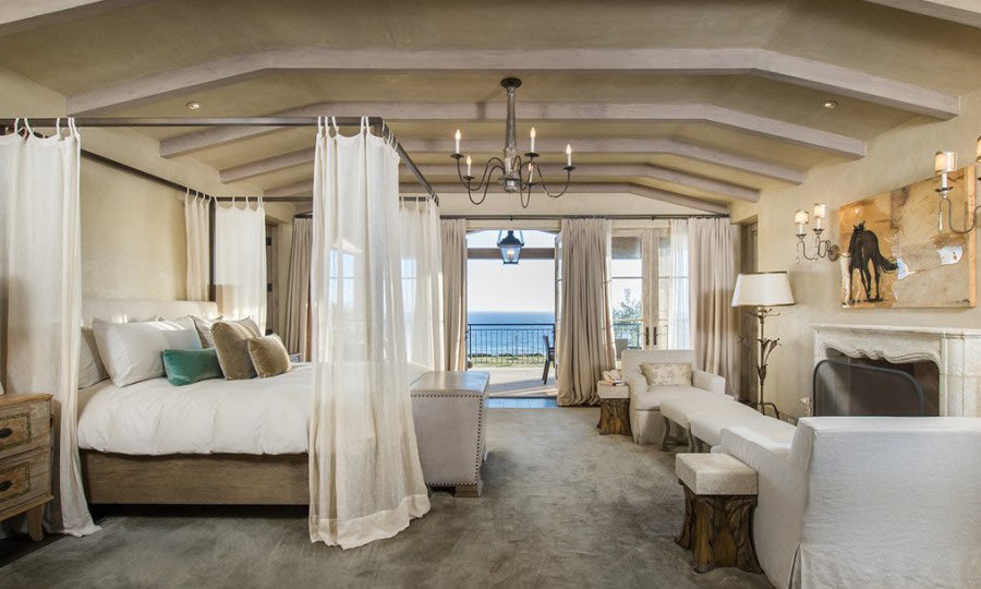 Lady Gaga's master bedroom looks a dream. Its stately size ensures that a California king fits comfortably, and its doors open up to expansive views of sandy beaches and clear waters. (Image: Zillow)