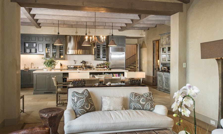 Lady Gaga's fairly open-concept home boasts a living room looking directly into the full-service chef's kitchen. (Image: Zillow)