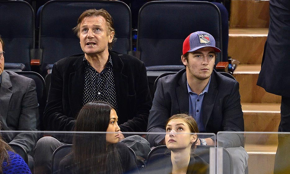 Liam Neeson and his lookalike youngest son, Daniel, were at the same game and enthralled by the action as the New York Islanders and the New York Rangers faced off. (Photo: James Devaney/GC Images/Getty Images)
