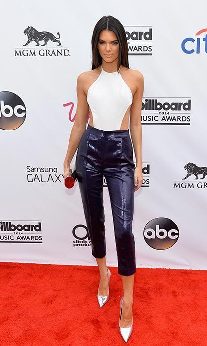 Stepping out for the 2014 Billboard Music Awards where she presented an award, the young model looked stunning in a bold white top and black trousers. Photo: © Getty Images