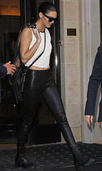 The stunning brunette rocked an edgy look with leather trousers and a studded biker jacket while out in Paris ahead of step-sister Kim Kardashian's wedding. Photo: © Getty Images