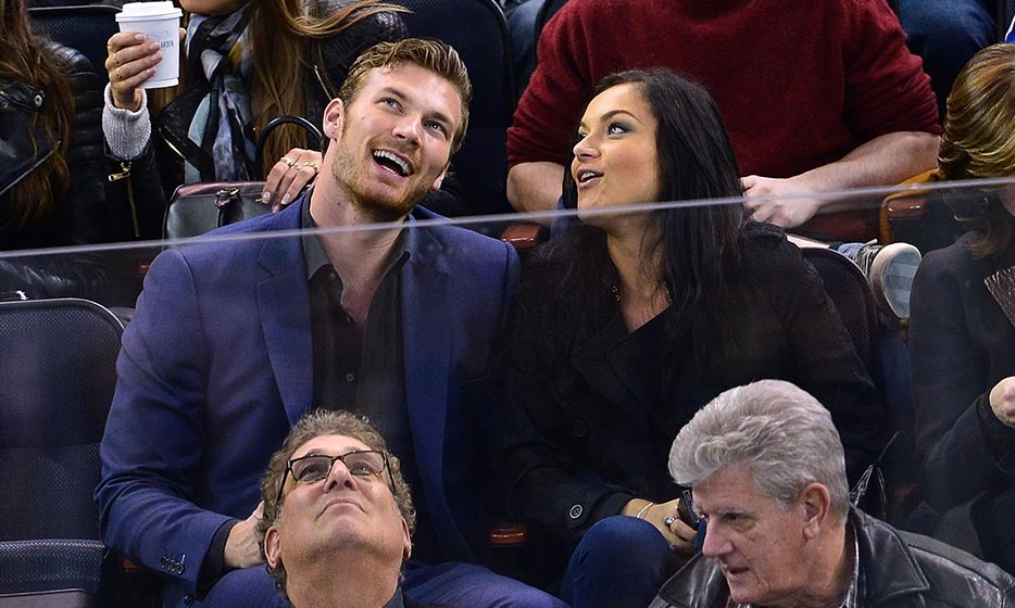 Derek Theler, who plays a hockey player on the show 'Baby Daddy', attended the Minnesota Wild vs New York Rangers game at Madison Square Garden on October 27, 2014 with Christina Ochoa. (Photo by James Devaney/GC Images/Getty Images)