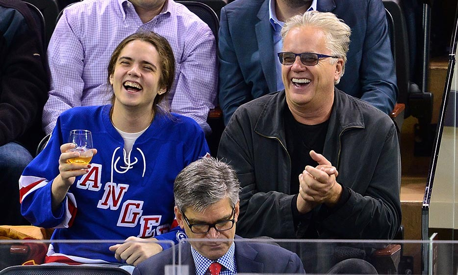 Tim Robbins and son Miles got animated at the Rangers game in October 2014.