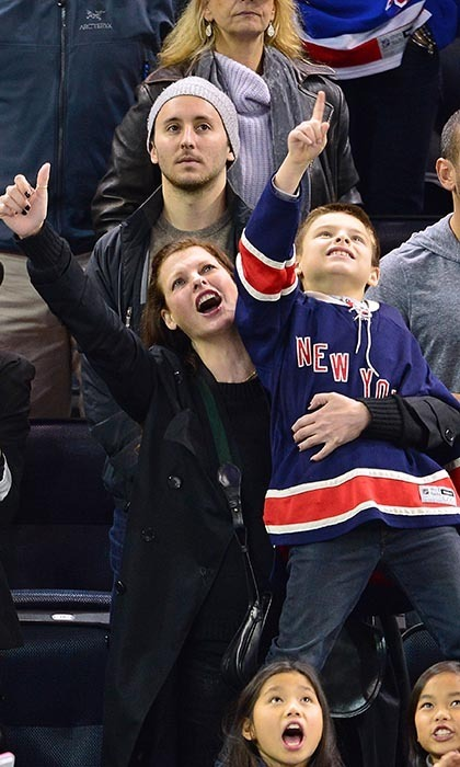Linda Evangelista and son Augustin at the Rangers game on November 1, 2014.