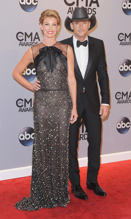 If you're going to walk a carpet with your partner, you may want to take a style cue from Faith Hill and her hubby Tim McGraw. The duo showed up at the CMAs sporting matching bow ties. Faith's look was sweet and feminine (without being overdone) and Tim's was all country without being tacky. (Photo: Getty Images)
