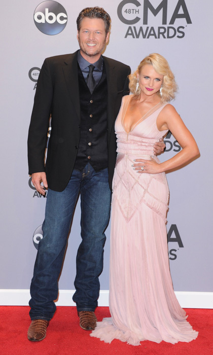 Hot couple alert! Miranda Lambert, the big winner of the night, arrived on the arm of her pulled-together hubby, Blake Shelton. She looked fantastic in a glamorous pink dress and droplet earrings; he went for casual cool in dark jeans and a tie. (Photo: Getty Images)