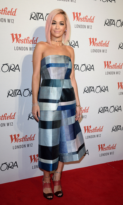 Rita Ora attended the Westfield London Christmas lights ceremony in a two-piece patchwork ensemble by U.K. brand Whistles and triple-strap Fendi heels. (Image: Getty Images)