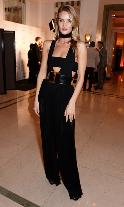 Rosie Huntington-Whiteley toed the line between risqué and elegant at the 'Harper's Bazaar' Women of the Year Awards in a plunging jumpsuit and black bandeau with matching collar and leather belt. (Image: Getty Images)