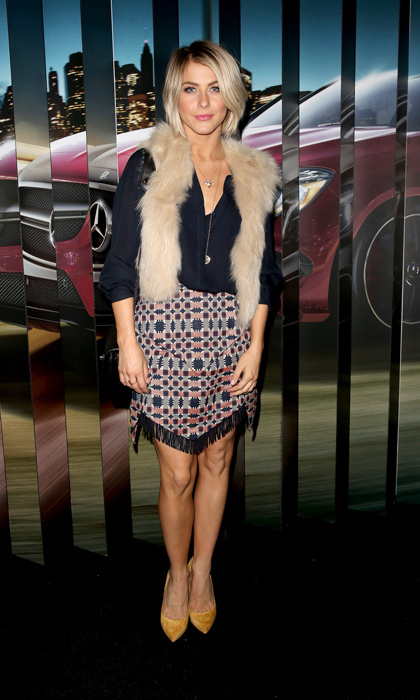 'Dancing With the Stars' judge Julianne Hough took a walk on the wild side in a faux-fur vest and printed skirt with fringe hem at the Mercedes Benz Evolution Tour in California. (Image: Getty Images)
