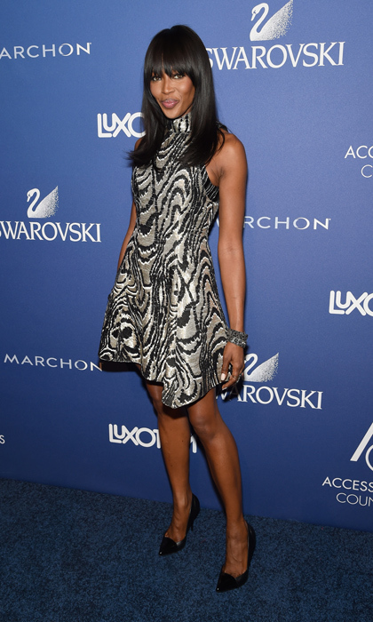 Supermodel Naomi Campbell attended the 18th Annual Accessories Council Awards in a silver, mod-inspired mini dress from Proenza Schouler's fall 2014 collection, leather pumps and studded cuffs. (Image: Getty Images)