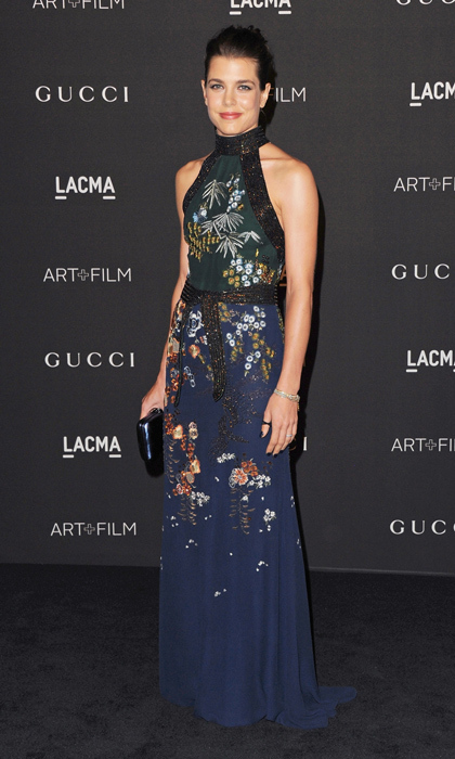 Monegasque royal and new mom Charlotte Casiraghi attended the LACMA Art + Film Gala in a delicately embroidered two-tone Gucci dress featuring a glittering leather trim. (Image: Getty Images)