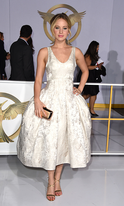 Jennifer Lawrence: The film's star, who plays Katniss Everdeen, looked lovely in pearlescent white Christian Dior Couture while strutting her way down the red carpet. She complemented her 1950s-inspired dress with a sweet updo and minimal accessories. (Photo: Getty Images)