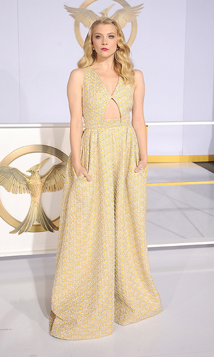Natalie Dormer: The 'Flare' cover girl plays a tough-as-nails member of the revolution in 'Mockingjay,' but she softened her look in a flawless Rochas gown with an on-trend cutout and delicate waves. (Photo: Getty Images)