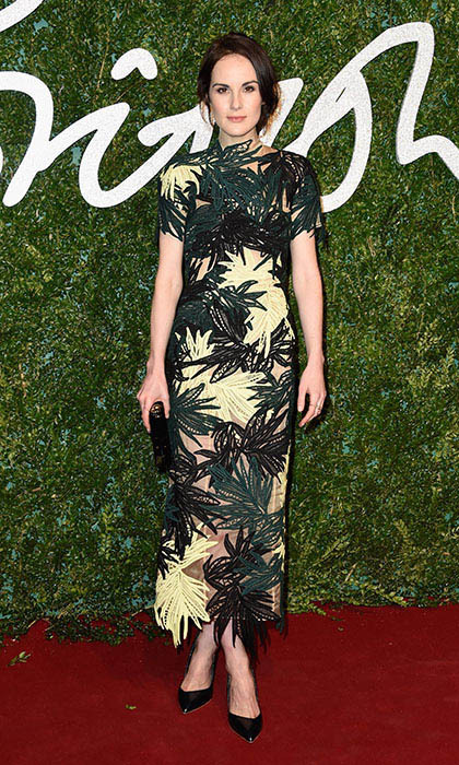 'Downton Abbey' star Michelle Dockery opted for statement-making Erdem at the British Fashion Awards, choosing a leaf-embroidered midi dress with sheer underlay and finishing it off with Melina Marie accessories and patent leather pumps.