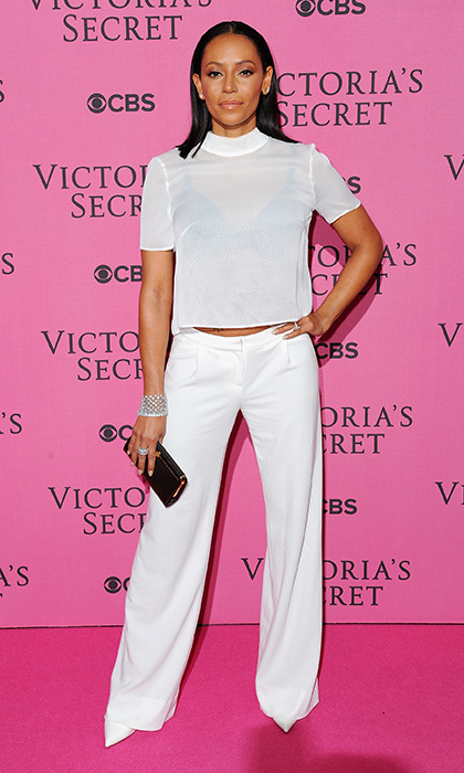'X-Factor UK' judge Mel B attended the Victoria's Secret fashion show in ivory silk trousers and a sheer mock-neck top, completing the ensemble with a crystal caged bracelet and diamond earrings.