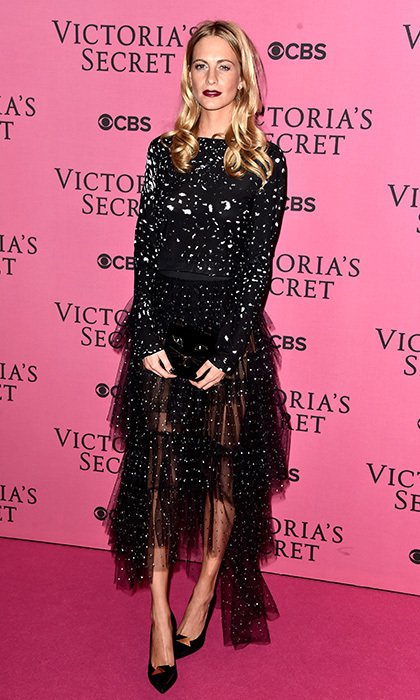 Poppy Delevingne hit the pink carpet of the Victoria's Secret fashion show in an achromatic two-piece featuring a cropped paint-splattered top and tiered tulle skirt