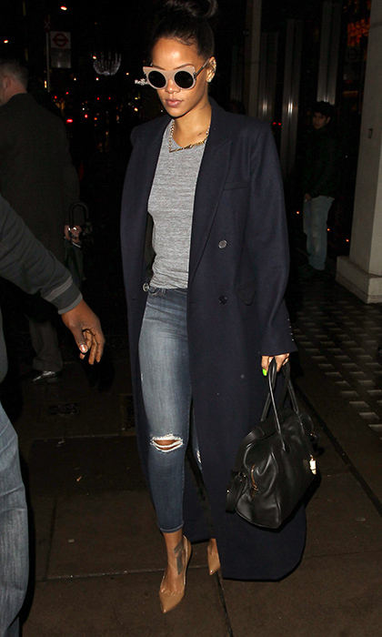 Rihanna made her way through London in a sleek look featuring Stella McCartney's nude cat-eye sunglasses, Reformation's Orson coat, J Brand skinny jeans and Christian Louboutin pumps.