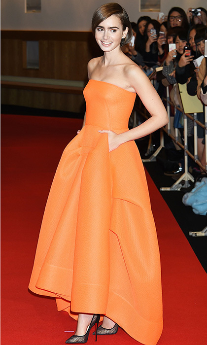 Actress Lily Cole brought a bold dose of colour to the Tokyo premiere of 'Love Rosie' in a structural orange gown by Maticevski, Christian Louboutin mesh pumps and jewels by Vita Fede.