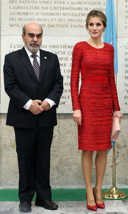 Queen Letizia wowed in red on a visit to Rome, posing with Jose Da Silva before a conference on nutrition. We love the texture on her otherwise demure red dress, which fits the royal to a tee. TIP: match your shoes to your dress but not your handbag, like Queen Letizia did here.