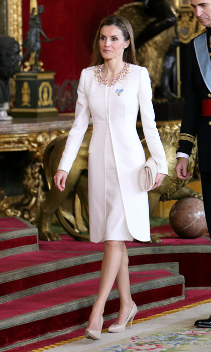 Take a cue from Queen Letizia's dress-and-jacket set with embellished neckline and nude accessories. Though the monarch slipped into the winter-white ensemble after her husband's coronation, we love the look for a festive luncheon.