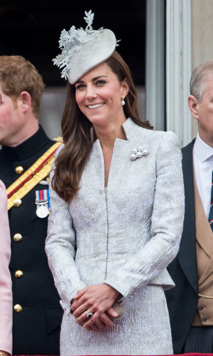 Slip into something silver this holiday season and you'll fit right in with all that tinsel! Kate was all smiles this past June at Trooping the Colour in London, and we're sure at least part of it was how good she felt in this perfectly tailored suit, with its striking neckline and baubled brooch.