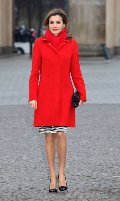 A vision in red, Queen Letizia donned an eye-catching coat and matching scarf on her first state visit to Berlin since assuming the throne in Spain. Mixing pops of cherry red with graphic black-and-white makes for a modern and merry seasonal look.