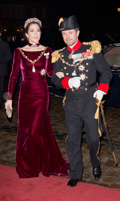 If you've got a formal holiday affair on the horizon, you'd be hard-pressed to find a gown more festive than Crown Princess Mary's red-velvet ensemble - and a date more decorated than her husband, Crown Prince Frederik. While the head piece might be a bit over the top for non-royal purposes, the matching velvet choker is simply stunning.