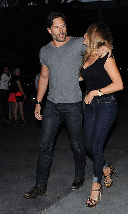Joe wrapped a protective arm around his love when they were spotted at the Staples Center in Los Angeles.