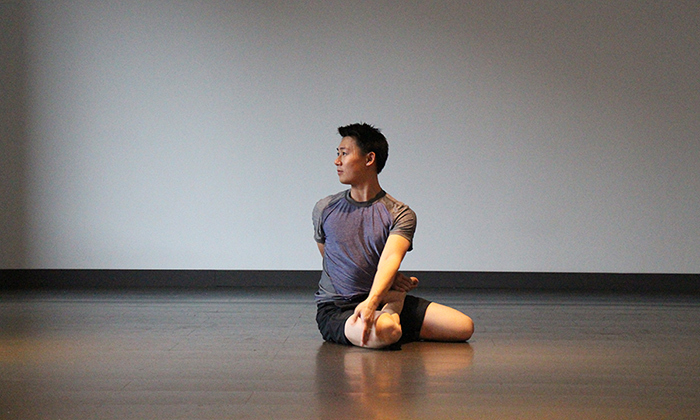 Bharadvaja Twist: This pose is very good for stretching the spine, hips and shoulders – and it's simple to get into! It involves sitting on the floor with your knees bent in front of you as you twist your upper torso. Photo © Yoga Tree