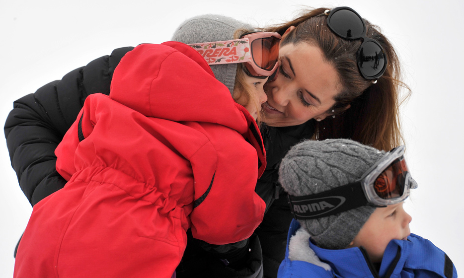 Doting mom Princess Mary gave her twins a warm embrace while on a skiing holiday in Verbier on Feb. 14, 2014.