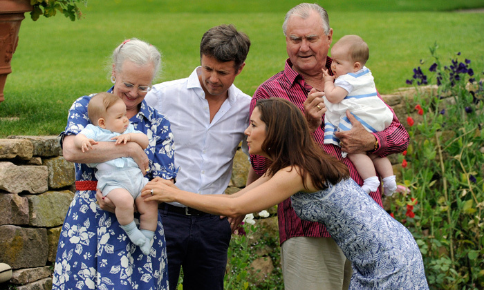 In a candid moment, Princess Mary was photographed playing with Prince Vincent as Queen Margrethe II, Prince Frederik and his father, Prince Henrik, looked on. 