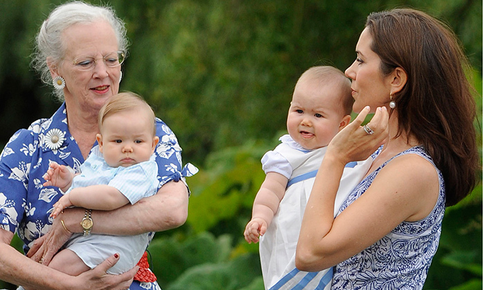 The twins' first summer: Queen Margrethe II was seen tenderly holding eight-month-old Prince Vincent as Princess Mary held Princess Josephine in August 2011. 
