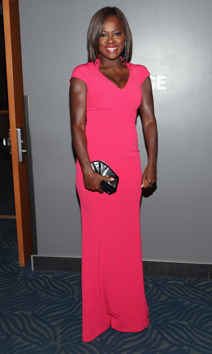 People's Choice Award-winner Viola Davis was all smiles backstage at the event in a punchy, floor-length Escada gown paired with a metallic Rauwolf clutch and Jacob & Co. jewels.