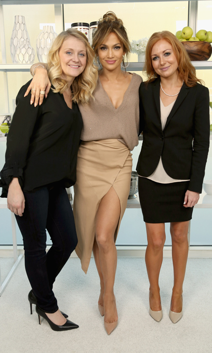 Jennifer Lopez struck a pose at the Santa Monica launch of her new BodyLab venture in a monochromatic look featuring an oversized beige knit, asymmetrical wrap skirt and nude Christian Louboutin pumps.