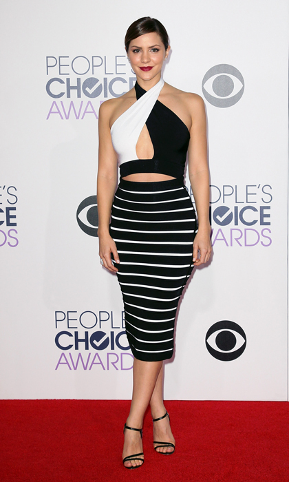 Katharine McPhee rocked the red carpet at the 2015 People's Choice Awards in a sexy two-toned ensemble by Balmain featuring a crossover halter top and striped pencil skirt paired with Daniele Michetti sandals.