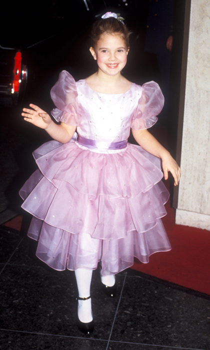 Eight-year-old Drew Barrymore was the centre of attention at the 1983 Golden Globes in a super-cute and age-appropriate princess-pink dress. (Photo by Barry King/WireImage)