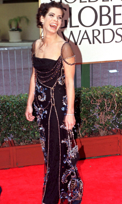 Sandra Bullock cemented her status as America's sweetheart in 1998 wearing a navy velvet gown with romantic embellishments. (Photo credit should read HAL GARB/AFP/Getty Images)